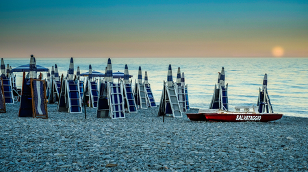 rescue boat on a beach at sunrise of the Ionian Sea. Calabria, Italy Reklamní fotografie