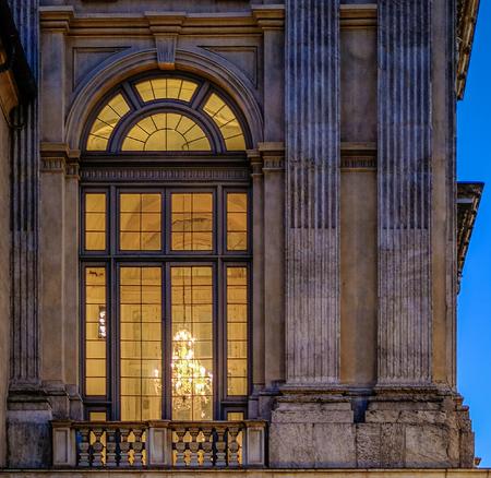 Large Madama palace lighted window by a chandelier. Turin, Italy Redakční