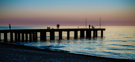 Silhouette of a pier at sunset on the Ionian sea. Calabria Italy Reklamní fotografie