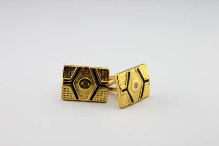 cufflinks on a white background close up  photo