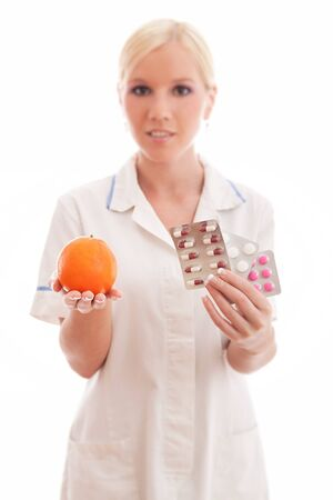 Doctor or nurse with orange and pills