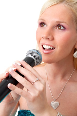 Portrait of beautiful blond singer girl with the microphone in hands Stock Photo - 8780787