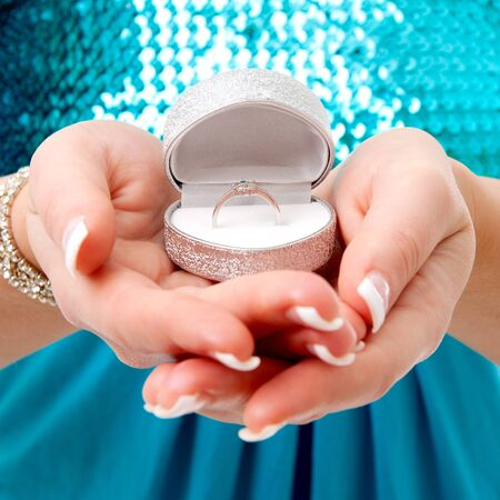 Hands with ring in box Stock Photo - 8780781
