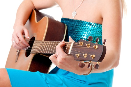 Closeup of a woman hands with acoustic guitar isolated on white background.