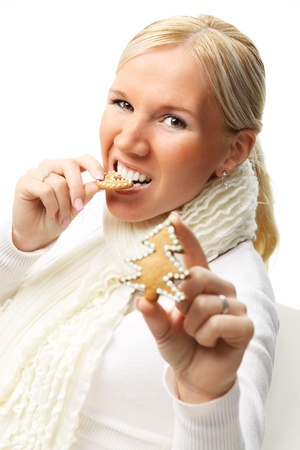 Young attractive woman with christmas cookies isolated over white background.  版權商用圖片