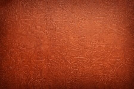 Closeup of brown leather textured background