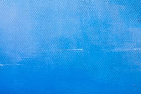 Blue painted canvas texture. Acrylic color paint.