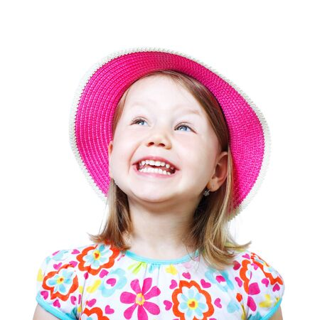 Studio portrait of a smiling little girl with pink hat isolated over white background.