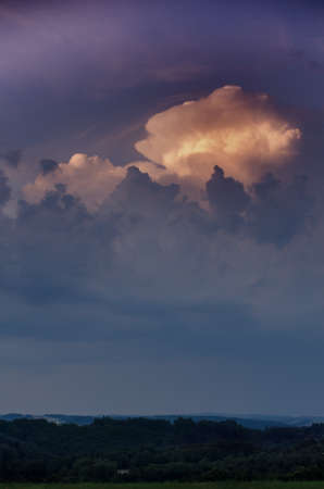 Background of storm clouds,dramatically illuminated clouds in the evening sky. Stock Photo