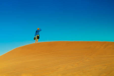 Alone in the desert.In the wilderness.Man stands alone on the sand dune.Traveling in the Sahara.