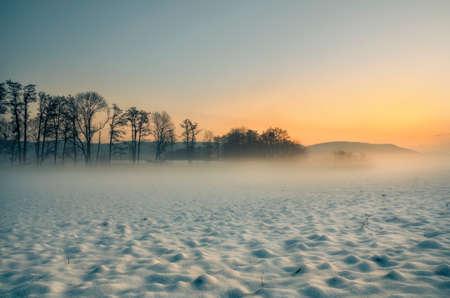 Sunset winter landscape.Fantastic winter landscape at sunset. colorful sky shining with sunlight. Dramatic winter scene.