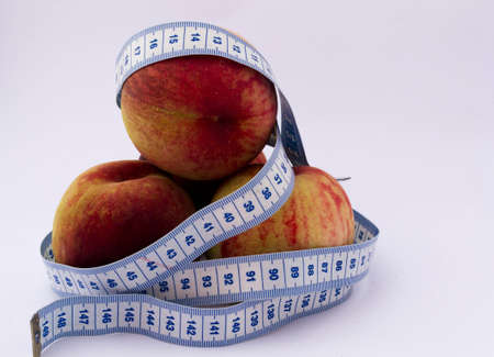 peaches and measuring tape Stock Photo