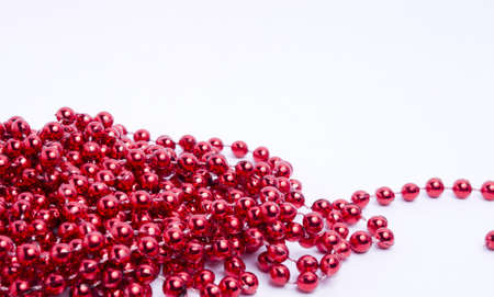 Red Christmas decorative beads on a light background  Stock Photo