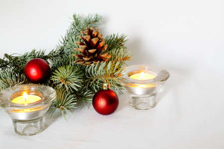 Christmas background with baubles, candle and pine branches.
