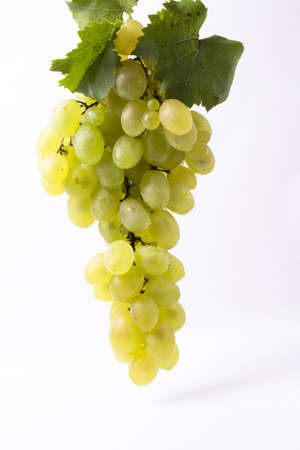 bunch of fresh juice with green leaves on white background