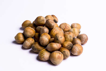 peanuts in a heap on white background Stock Photo