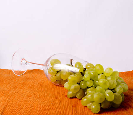 grapes in the wine glass base material