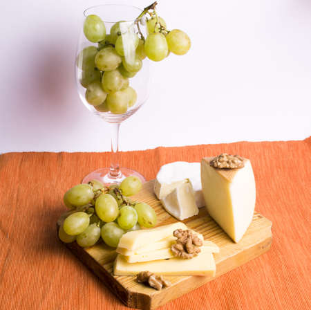 Grape and cheese with a bottle and glasses of