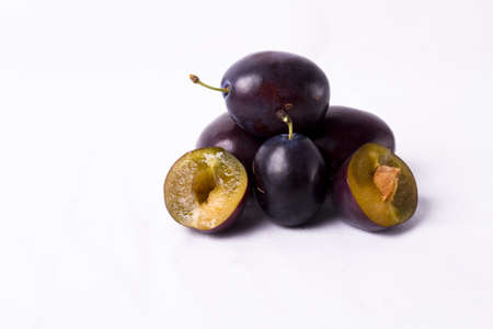 purple plums on white background beautiful healthy