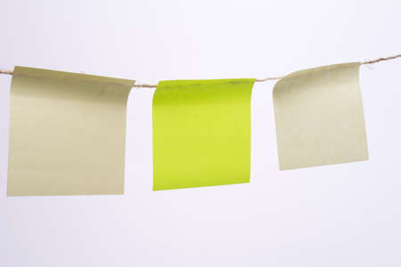 Stack of colorful sticky notes with yellow on top, blank
