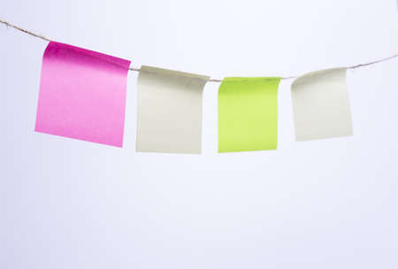 Multi-colored Post-it note paper hanging from clothesline photo