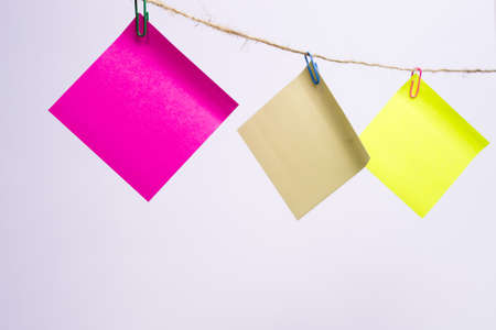 colored notes paper clipped corners of the rope