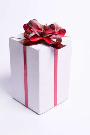 white box with red ribbon and bow