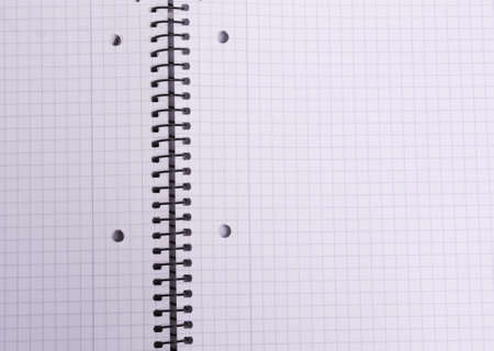 checkered sheet spiral notebook background to use