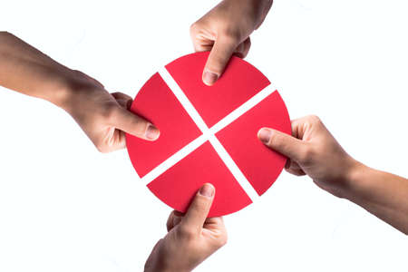 red circle on white puzzle combining the four quarters Stock Photo