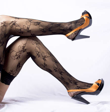Sexy and funny shoes on a white background with orange legs