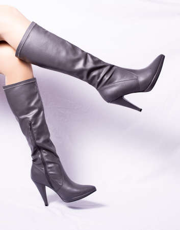 leather goods: pair of gray boots, white background, women