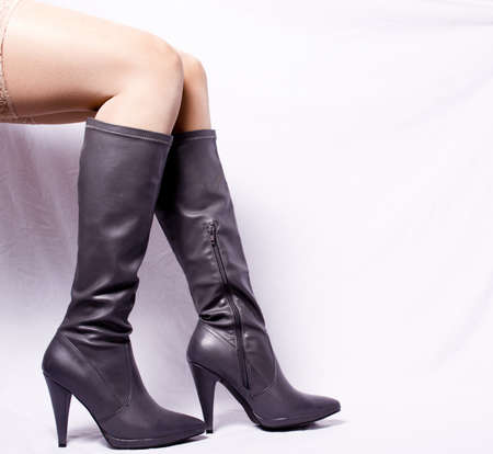 Sheer gray and white boots sitting position in the background Stock Photo