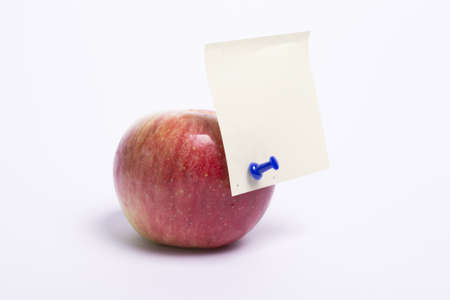 apple and notes paper on white background
