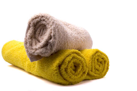 Turvan making up a stack of towels on white background