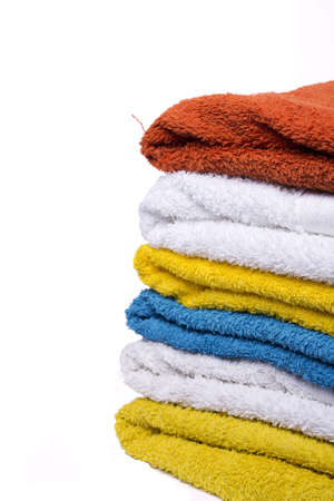washed nicely color coordinated towels white background Stock Photo