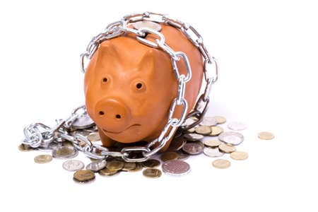 piggy-bank locks, chained and locked on white background Stock Photo