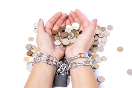 hands chained to the bank the money saved to startup Stock Photo