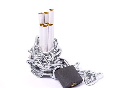 a pile of cigarettes safely out of reach of chains and padlocks Stock Photo