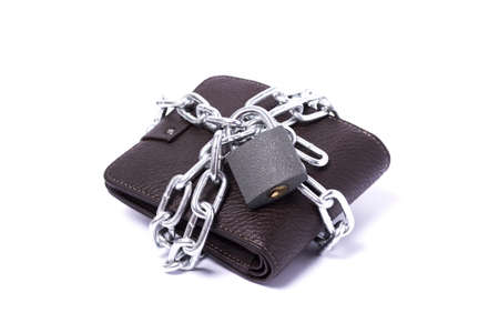 dark brown wallet with chain and padlock wrapped around the closed white background Stock Photo - 11070212