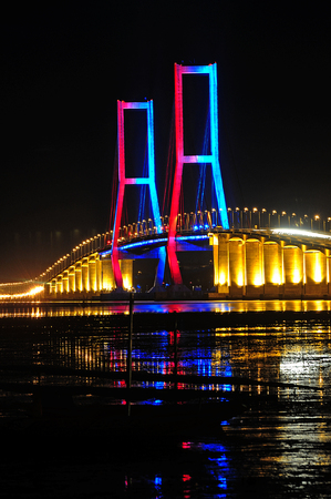 Suramadu bridge that conecting Surabaya City (Java Island) and Madura island at surabaya, East Java, Indonesia. Suramdu has a length of 5, 438 m
