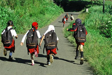 village man: Childrens go to school in the village Ranupane, Lumajang, East Java, Indonesia. Photo taken on May 20th, 2009.