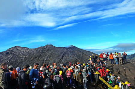 tengger: Tourists eager to see smoking Bromo crater from close distance in National park Bromo Tengger Semeru