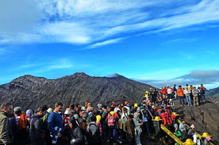 tengger: Tourists eager to see smoking Bromo crater from close distance in National park Bromo Tengger Semeru