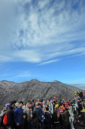eager: Tourists eager to see smoking Bromo crater from close distance in National park Bromo Tengger Semeru
