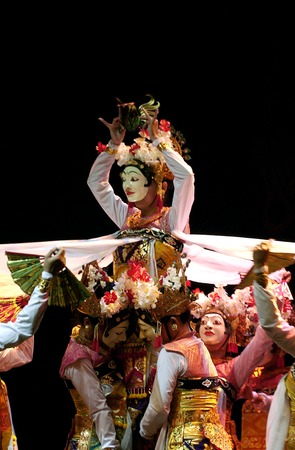 Bali dance wearing masks in staging in Surabaya Indonesia
