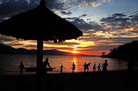 childrens playing: Childrens playing alongside a Kelapa beach DIli Timor Leste