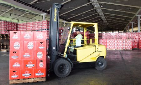 storeroom: Mojokerto East Java Indonesia  April 9 2015: Workers transporting bottled beer star in beverage production in Trawas Mojokerto East Java. Indonesia has banned small retailers from selling beer despite an outcry from the booze industry and in tourism hotsp