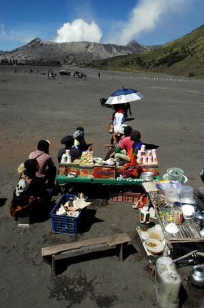 nusa: Vendors selling drinks in the desert near the crater of Mount Bromo East Java Indonesia Editorial
