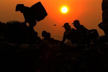 landfills: Silhouette find garbage in landfills Benowo, Surabaya, Indonesia. Photo taken on: July 20, 2006