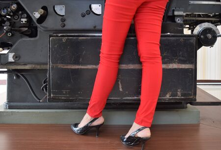 habiliment: This red pants with background printing machines Stock Photo